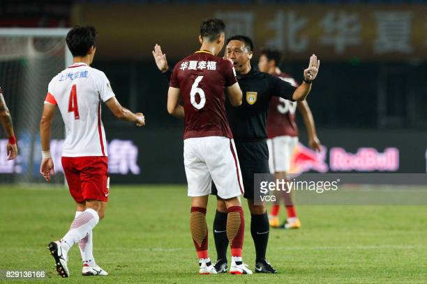 Luo Senwen of Hebei China Fortune speaks with referee during the 21st round match of 2017 China Super League between Hebei China Fortune FC and...