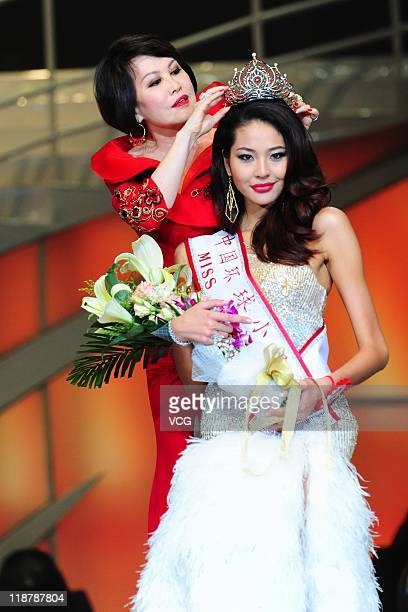 Luo Zilin is crowned the 2011 Miss Universe China by Chinese American YueSai Kan during the 2011 Miss Universe China final at MasterCard Center on...