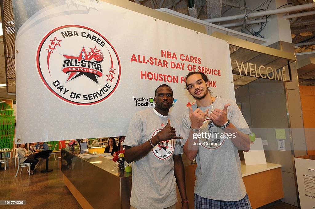 Luol Deng #9 and Joakim Noah #13 of the Chicago Bulls at the 2013 NBA Cares Day of Service at the Food Bank sorting on February 15, 2013 in Houston, Texas.