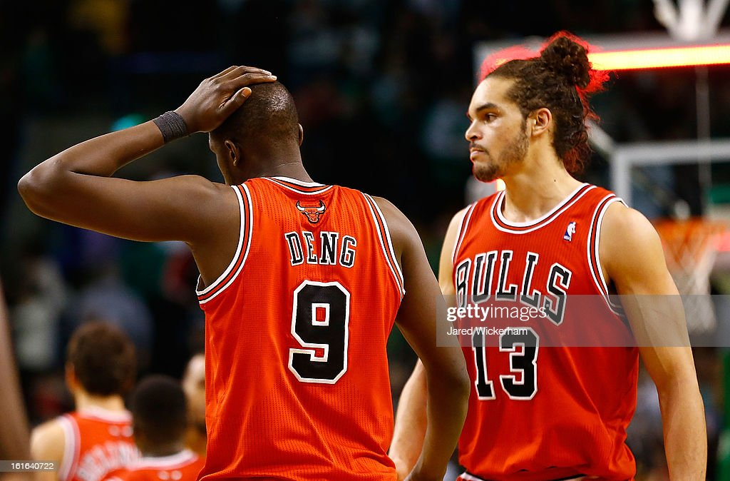 Luol Deng #9 and Joakim Noah #13 of the Chicago Bulls walk off of the court following their 71-69 loss against the Boston Celtics during the game on February 13, 2013 at TD Garden in Boston, Massachusetts.