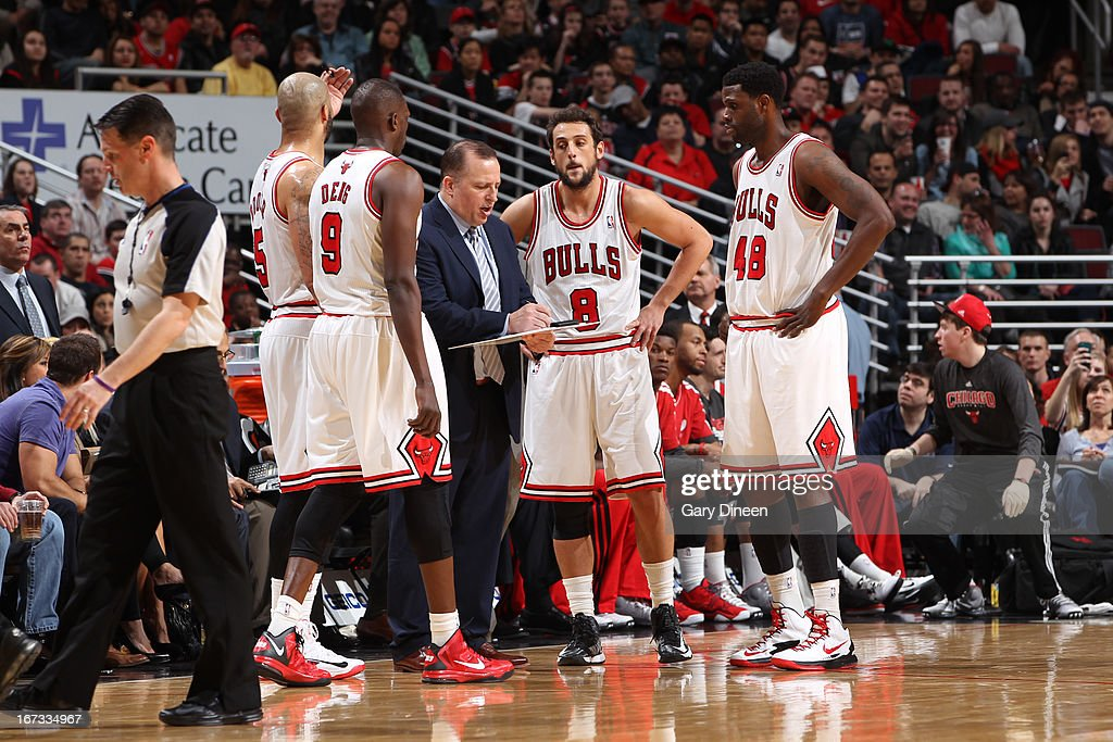 <a gi-track='captionPersonalityLinkClicked' href=/galleries/search?phrase=Luol+Deng&family=editorial&specificpeople=202830 ng-click='$event.stopPropagation()'>Luol Deng</a> #9 and the Chicago Bulls huddle up during the game against the Indiana Pacers on March 23, 2013 at the United Center in Chicago, Illinois.