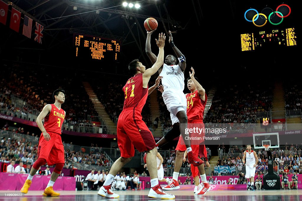 <a gi-track='captionPersonalityLinkClicked' href=/galleries/search?phrase=Luol+Deng&family=editorial&specificpeople=202830 ng-click='$event.stopPropagation()'>Luol Deng</a> #9 of Great Britain drives for a shot attempt against <a gi-track='captionPersonalityLinkClicked' href=/galleries/search?phrase=Yi+Jianlian&family=editorial&specificpeople=646125 ng-click='$event.stopPropagation()'>Yi Jianlian</a> #11 and <a gi-track='captionPersonalityLinkClicked' href=/galleries/search?phrase=Wang+Zhizhi&family=editorial&specificpeople=206930 ng-click='$event.stopPropagation()'>Wang Zhizhi</a> #14 of China during the Men's Basketball Preliminary Round match on Day 10 of the London 2012 Olympic Games at the Basketball Arena on August 6, 2012 in London, England.