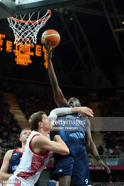 Luol Deng of Great Britain goes for a layup against Timofey Mozgov of Russia during their Men's Basketball Game on Day 2 of the London 2012 Olympic...