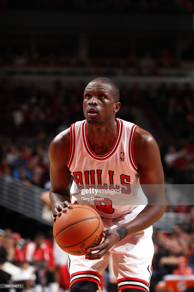 <a gi-track='captionPersonalityLinkClicked' href=/galleries/search?phrase=Luol+Deng&family=editorial&specificpeople=202830 ng-click='$event.stopPropagation()'>Luol Deng</a> #9 of the Chicago Bulls attempts a foul shot against the Milwaukee Bucks on January 9, 2013 at the United Center in Chicago, Illinois.