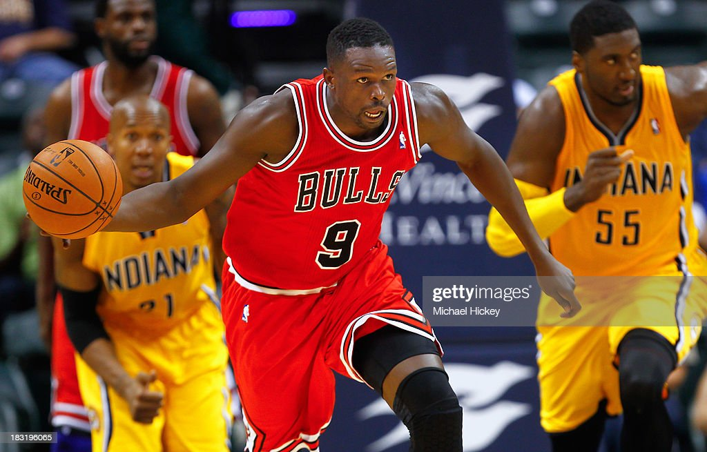 <a gi-track='captionPersonalityLinkClicked' href=/galleries/search?phrase=Luol+Deng&family=editorial&specificpeople=202830 ng-click='$event.stopPropagation()'>Luol Deng</a> #9 of the Chicago Bulls brings the ball up court against the Indiana Pacers on October 5, 2013 at Bankers Life Fieldhouse in Indianapolis, Indiana. Chicago defeated Indiana 82-76.