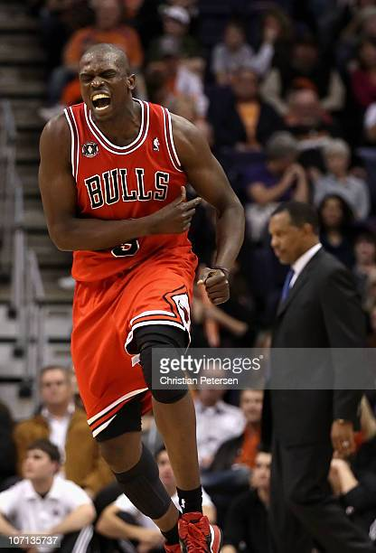 Luol Deng of the Chicago Bulls celebrates after scoring against the Phoenix Suns late in overtime of the NBA game at US Airways Center on November 24...