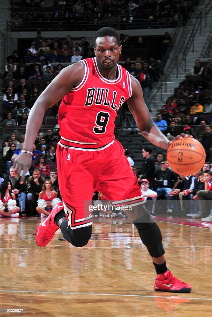 <a gi-track='captionPersonalityLinkClicked' href=/galleries/search?phrase=Luol+Deng&family=editorial&specificpeople=202830 ng-click='$event.stopPropagation()'>Luol Deng</a> #9 of the Chicago Bulls dribbles the ball against the Detroit Pistons on November 27, 2013 at The Palace of Auburn Hills in Auburn Hills, Michigan.