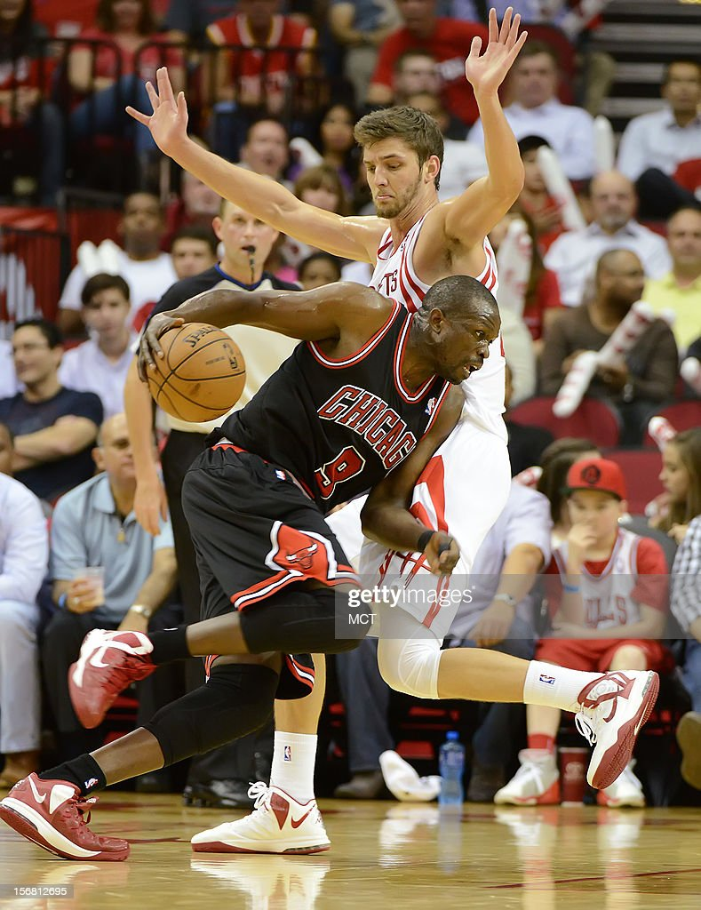 Luol Deng (9) of the Chicago Bulls drives against Chandler Parsons (25) of the Houston Rockets in the second half of the Rockets' 93-89 victory on Wednesday, November 21, 2012, in Houston, Texas.