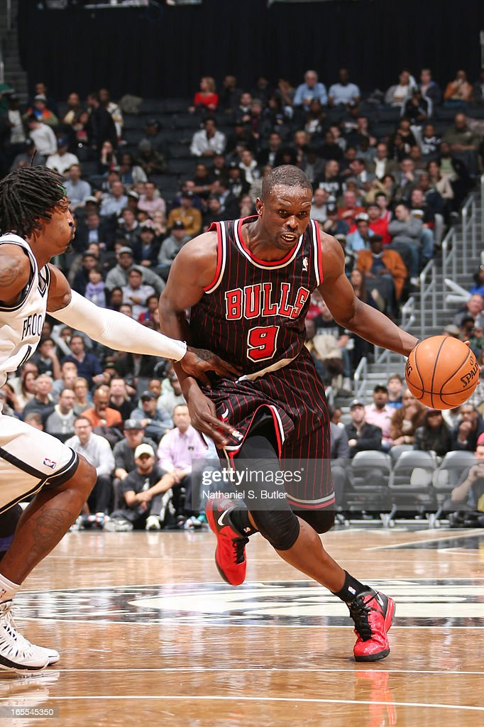 Luol Deng #9 of the Chicago Bulls drives against Gerald Wallace #45 of the Brooklyn Nets on April 4, 2013 at the Barclays Center in the Brooklyn borough of New York City.