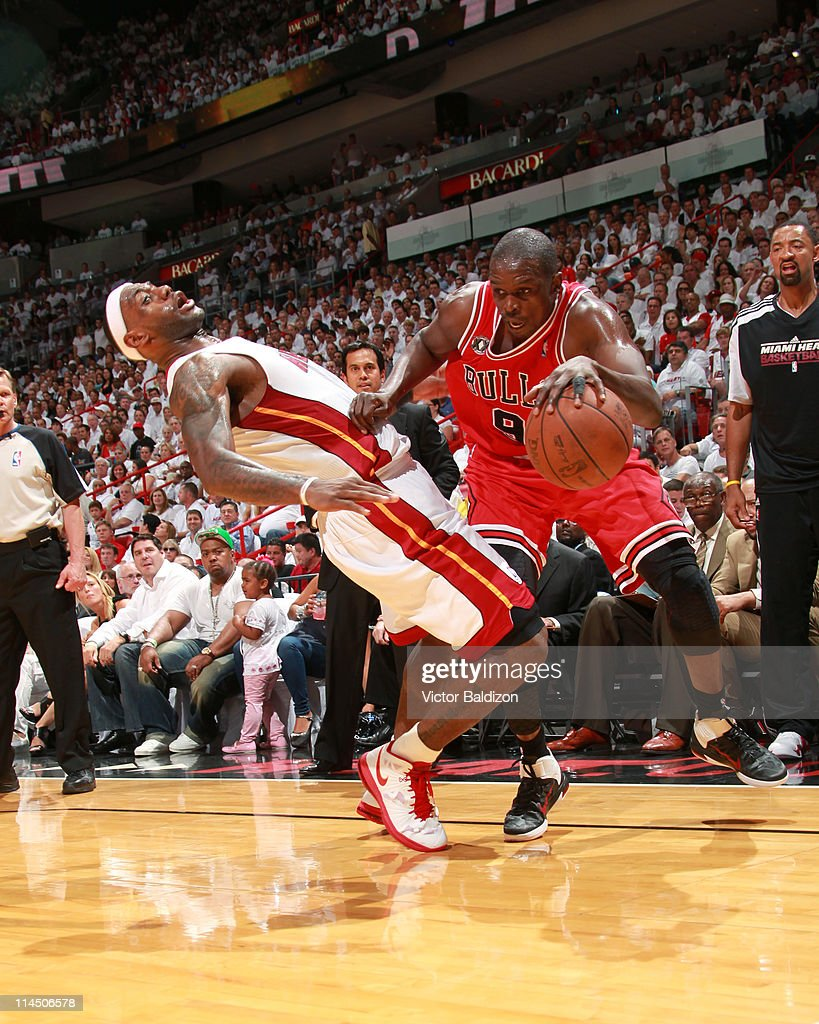 <a gi-track='captionPersonalityLinkClicked' href=/galleries/search?phrase=Luol+Deng&family=editorial&specificpeople=202830 ng-click='$event.stopPropagation()'>Luol Deng</a> #9 of the Chicago Bulls drives against <a gi-track='captionPersonalityLinkClicked' href=/galleries/search?phrase=LeBron+James&family=editorial&specificpeople=201474 ng-click='$event.stopPropagation()'>LeBron James</a> #6 of the Miami Heat during Game Three of the Eastern Conference Finals in the 2011 NBA Playoffs on May 22, 2011 at American Airlines Arena in Miami, Florida.