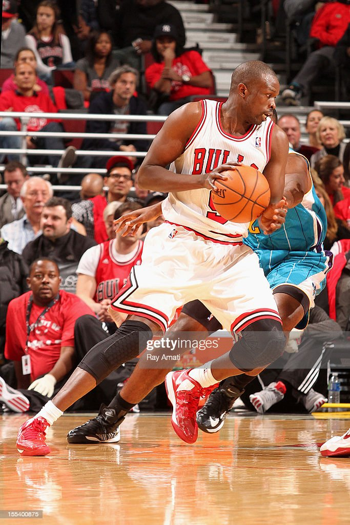 <a gi-track='captionPersonalityLinkClicked' href=/galleries/search?phrase=Luol+Deng&family=editorial&specificpeople=202830 ng-click='$event.stopPropagation()'>Luol Deng</a> #9 of the Chicago Bulls drives past Brian Roberts #22 of the New Orleans Hornets during the game on November 3, 2012 at the United Center in Chicago, Illinois.