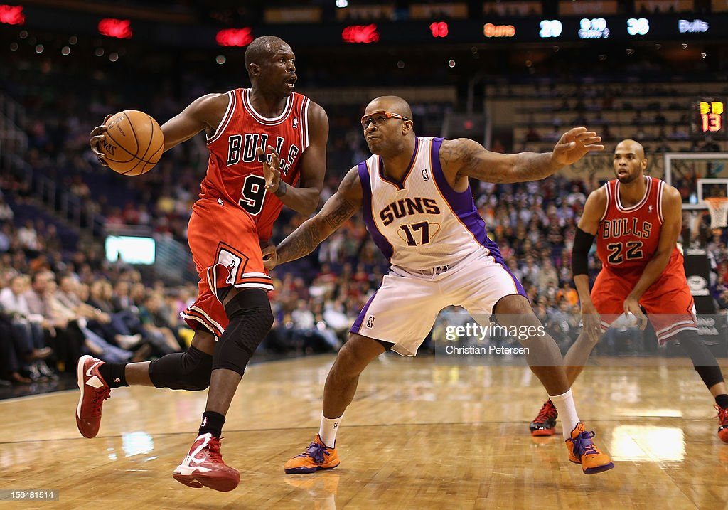Luol Deng #9 of the Chicago Bulls drives the ball against P.J. Tucker #17 of the Phoenix Suns during the NBA game at US Airways Center on November 14, 2012 in Phoenix, Arizona. The Bulls defeated the Suns 112-106 in overtime.