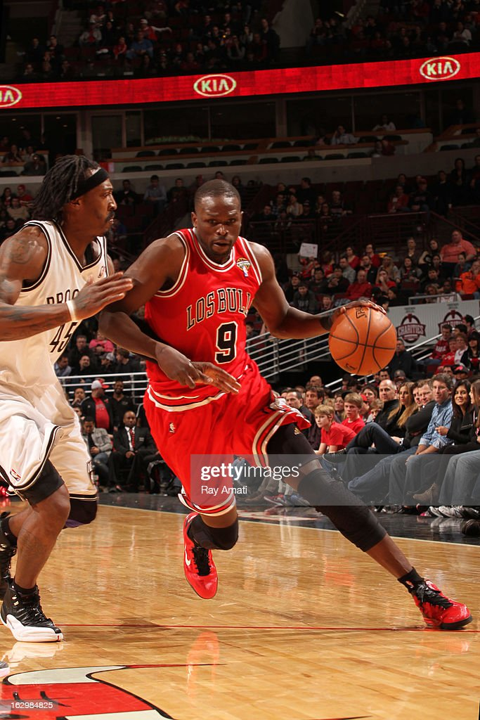 Luol Deng #9 of the Chicago Bulls drives to the basket against Gerald Wallace #45 of the Brooklyn Nets on March 2, 2013 at the United Center in Chicago, Illinois.