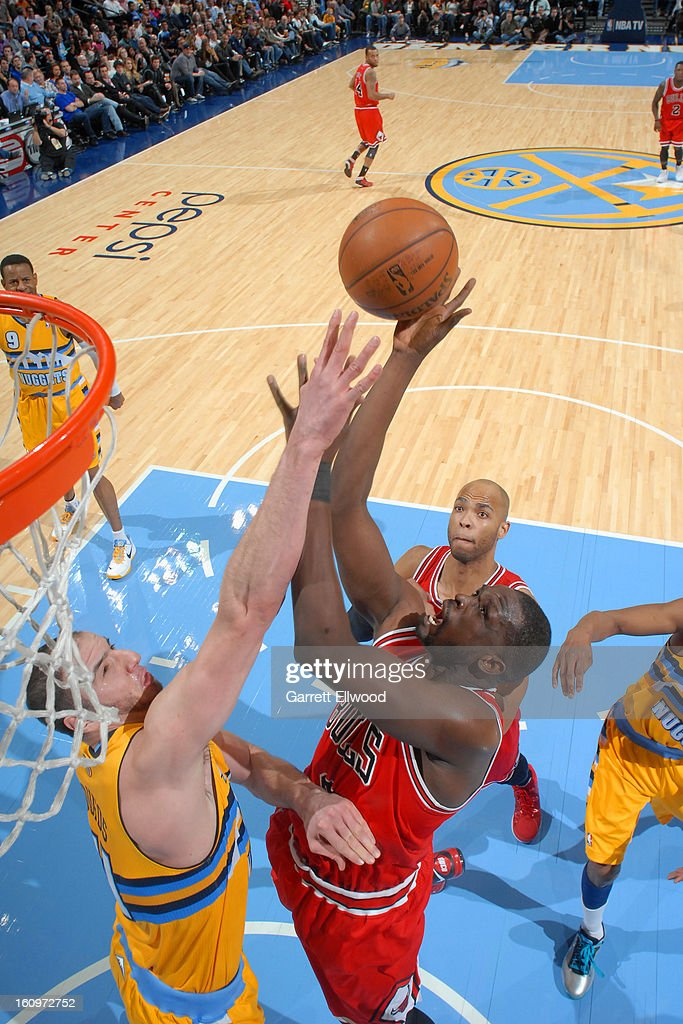 <a gi-track='captionPersonalityLinkClicked' href=/galleries/search?phrase=Luol+Deng&family=editorial&specificpeople=202830 ng-click='$event.stopPropagation()'>Luol Deng</a> #9 of the Chicago Bulls drives to the basket against <a gi-track='captionPersonalityLinkClicked' href=/galleries/search?phrase=Kosta+Koufos&family=editorial&specificpeople=4216032 ng-click='$event.stopPropagation()'>Kosta Koufos</a> #41 of the Denver Nuggets on February 7, 2013 at the Pepsi Center in Denver, Colorado.