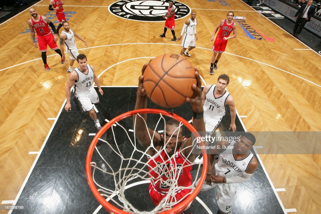 <a gi-track='captionPersonalityLinkClicked' href=/galleries/search?phrase=Luol+Deng&family=editorial&specificpeople=202830 ng-click='$event.stopPropagation()'>Luol Deng</a> #9 of the Chicago Bulls drives to the basket against the Brooklyn Nets in Game Two of the Eastern Conference Quarterfinals during the 2013 NBA Playoffs on April 22 at the Barclays Center in the Brooklyn borough of New York City.