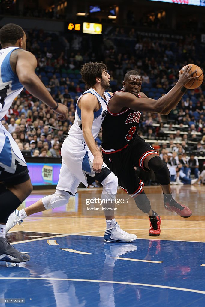 <a gi-track='captionPersonalityLinkClicked' href=/galleries/search?phrase=Luol+Deng&family=editorial&specificpeople=202830 ng-click='$event.stopPropagation()'>Luol Deng</a> #9 of the Chicago Bulls drives to the basket against the Minnesota Timberwolves on March 24, 2013 at Target Center in Minneapolis, Minnesota.