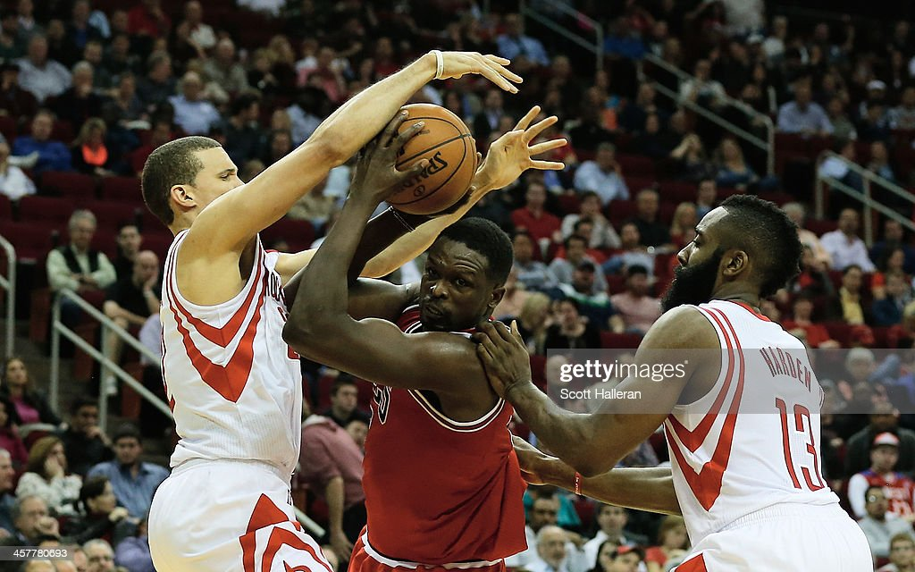 <a gi-track='captionPersonalityLinkClicked' href=/galleries/search?phrase=Luol+Deng&family=editorial&specificpeople=202830 ng-click='$event.stopPropagation()'>Luol Deng</a> #9 of the Chicago Bulls drives with the ball against Francisco Garcia #32 and <a gi-track='captionPersonalityLinkClicked' href=/galleries/search?phrase=James+Harden&family=editorial&specificpeople=4215938 ng-click='$event.stopPropagation()'>James Harden</a> #13 of the Houston Rockets during the game at Toyota Center on December 18, 2013 in Houston, Texas.