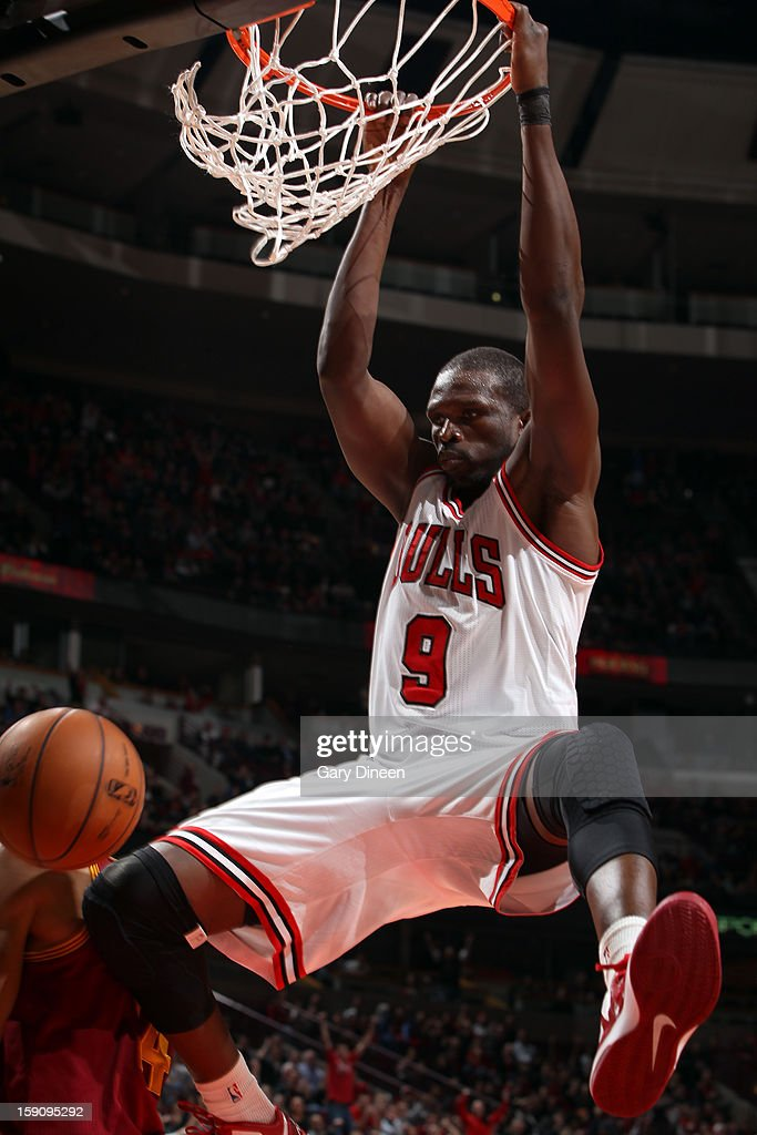 <a gi-track='captionPersonalityLinkClicked' href=/galleries/search?phrase=Luol+Deng&family=editorial&specificpeople=202830 ng-click='$event.stopPropagation()'>Luol Deng</a> #9 of the Chicago Bulls dunks against the Cleveland Cavaliers on January 7, 2013 at the United Center in Chicago, Illinois.