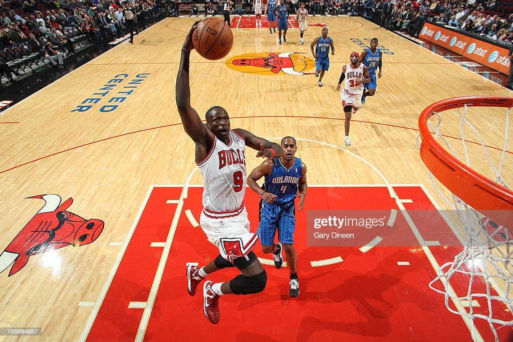 <a gi-track='captionPersonalityLinkClicked' href=/galleries/search?phrase=Luol+Deng&family=editorial&specificpeople=202830 ng-click='$event.stopPropagation()'>Luol Deng</a> #9 of the Chicago Bulls dunks against the Orlando Magic during the NBA game on November 6, 2012 at the United Center in Chicago, Illinois.