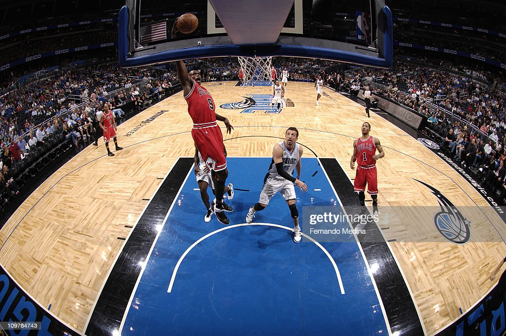 <a gi-track='captionPersonalityLinkClicked' href=/galleries/search?phrase=Luol+Deng&family=editorial&specificpeople=202830 ng-click='$event.stopPropagation()'>Luol Deng</a> #9 of the Chicago Bulls dunks over <a gi-track='captionPersonalityLinkClicked' href=/galleries/search?phrase=Hedo+Turkoglu&family=editorial&specificpeople=201639 ng-click='$event.stopPropagation()'>Hedo Turkoglu</a> #15 of the Orlando Magic on March 4, 2011 at the Amway Center in Orlando, Florida.
