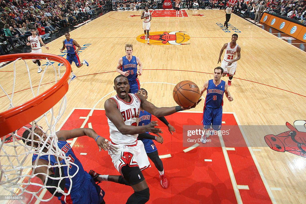 <a gi-track='captionPersonalityLinkClicked' href=/galleries/search?phrase=Luol+Deng&family=editorial&specificpeople=202830 ng-click='$event.stopPropagation()'>Luol Deng</a> #9 of the Chicago Bulls goes to the basket past <a gi-track='captionPersonalityLinkClicked' href=/galleries/search?phrase=Greg+Monroe&family=editorial&specificpeople=5042440 ng-click='$event.stopPropagation()'>Greg Monroe</a> #10 of the Detroit Pistons on March 31, 2013 at the United Center in Chicago, Illinois.