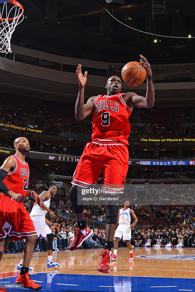 <a gi-track='captionPersonalityLinkClicked' href=/galleries/search?phrase=Luol+Deng&family=editorial&specificpeople=202830 ng-click='$event.stopPropagation()'>Luol Deng</a> #9 of the Chicago Bulls grabs the rebound against the Philadelphia 76ers on December 12, 2012 at the Wells Fargo Center in Philadelphia, Pennsylvania.