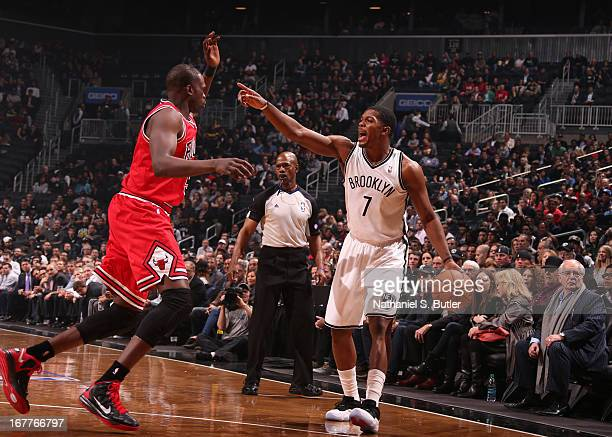 Luol Deng of the Chicago Bulls guards Joe Johnson of the Brooklyn Nets in Game Five of the Eastern Conference Quarterfinals during the 2013 NBA...