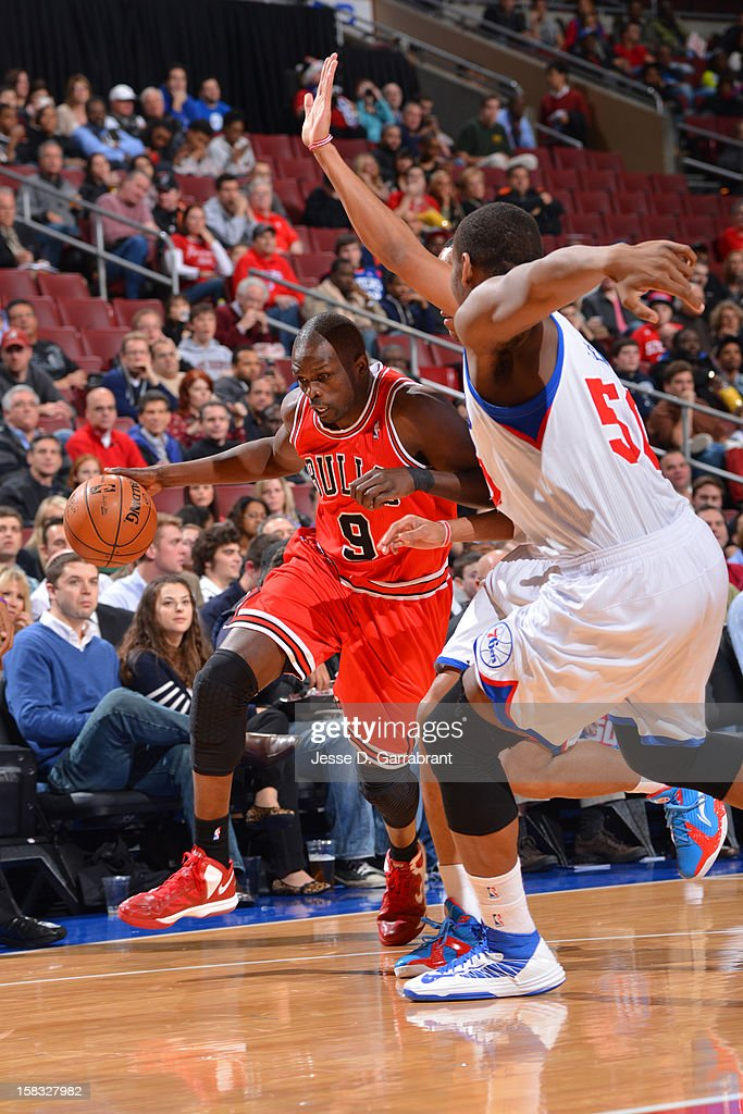 <a gi-track='captionPersonalityLinkClicked' href=/galleries/search?phrase=Luol+Deng&family=editorial&specificpeople=202830 ng-click='$event.stopPropagation()'>Luol Deng</a> #9 of the Chicago Bulls handles the ball against the Philadelphia 76ers on December 12, 2012 at the Wells Fargo Center in Philadelphia, Pennsylvania.