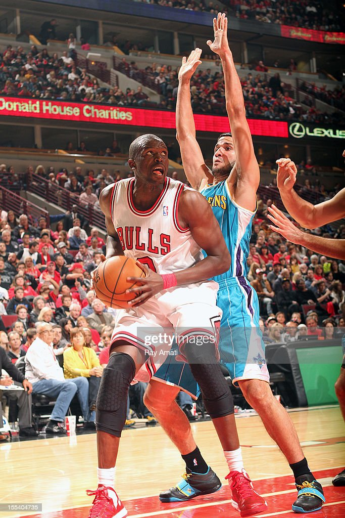 <a gi-track='captionPersonalityLinkClicked' href=/galleries/search?phrase=Luol+Deng&family=editorial&specificpeople=202830 ng-click='$event.stopPropagation()'>Luol Deng</a> #9 of the Chicago Bulls looks to the basket while guarded by Ryan Anderson #33 of the New Orleans Hornets during the game on November 3, 2012 at the United Center in Chicago, Illinois.
