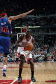 Luol Deng of the Chicago Bulls moves the ball against Rasheed Wallace of the Detroit Pistons in Game Three of the Eastern Conference Semifinals...
