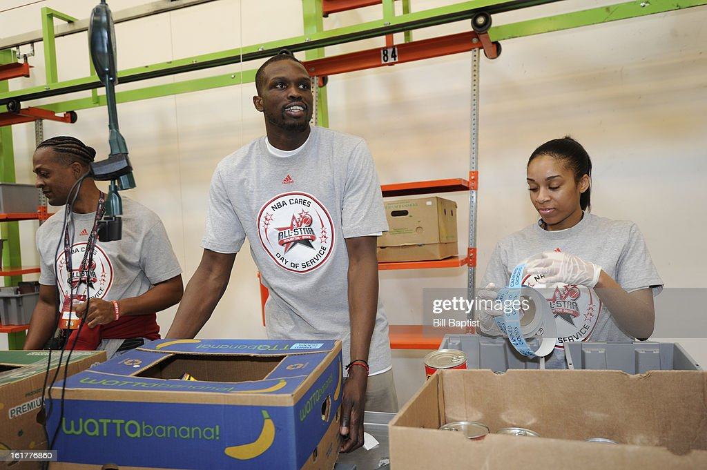 Luol Deng #9 of the Chicago Bulls participates at the 2013 NBA Cares Day of Service at the Food Bank sorting on February 15, 2013 in Houston, Texas.