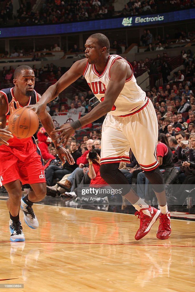 <a gi-track='captionPersonalityLinkClicked' href=/galleries/search?phrase=Luol+Deng&family=editorial&specificpeople=202830 ng-click='$event.stopPropagation()'>Luol Deng</a> #9 of the Chicago Bulls passes the ball against <a gi-track='captionPersonalityLinkClicked' href=/galleries/search?phrase=Martell+Webster&family=editorial&specificpeople=601785 ng-click='$event.stopPropagation()'>Martell Webster</a> #9 of the Washington Wizards on December 29, 2012 at the United Center in Chicago, Illinois.