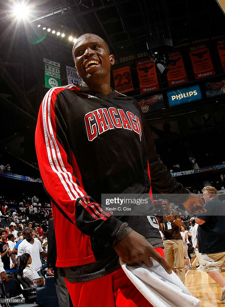 <a gi-track='captionPersonalityLinkClicked' href=/galleries/search?phrase=Luol+Deng&family=editorial&specificpeople=202830 ng-click='$event.stopPropagation()'>Luol Deng</a> #9 of the Chicago Bulls reacts after their 93-73 win over the Atlanta Hawks in Game Six of the Eastern Conference Semifinals in the 2011 NBA Playoffs at Phillips Arena on May 12, 2011 in Atlanta, Georgia.