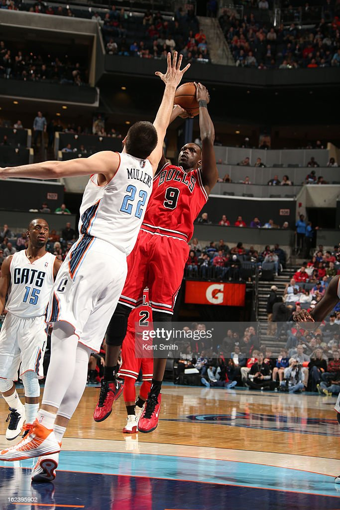 <a gi-track='captionPersonalityLinkClicked' href=/galleries/search?phrase=Luol+Deng&family=editorial&specificpeople=202830 ng-click='$event.stopPropagation()'>Luol Deng</a> #9 of the Chicago Bulls shoots against Byron Mullens #22 of the Charlotte Bobcats at the Time Warner Cable Arena on February 22, 2013 in Charlotte, North Carolina.