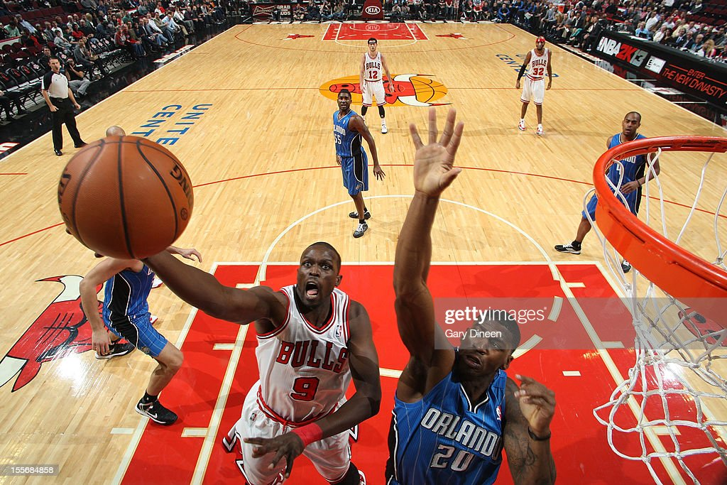 <a gi-track='captionPersonalityLinkClicked' href=/galleries/search?phrase=Luol+Deng&family=editorial&specificpeople=202830 ng-click='$event.stopPropagation()'>Luol Deng</a> #9 of the Chicago Bulls shoots against DeQuan Jones #20 of the Orlando Magic during the NBA game on November 6, 2012 at the United Center in Chicago, Illinois.