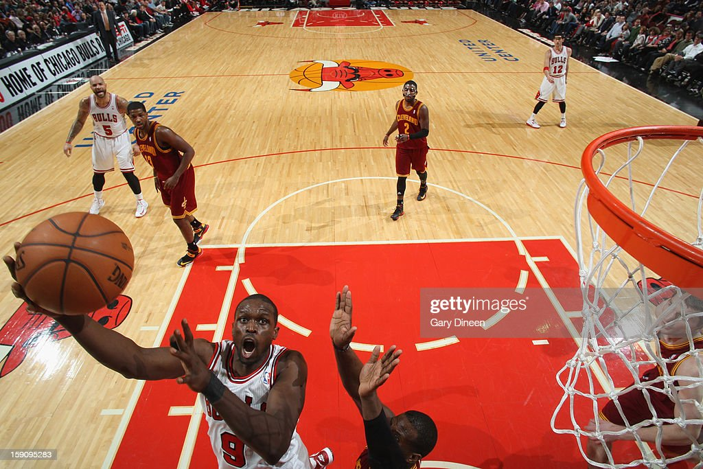 <a gi-track='captionPersonalityLinkClicked' href=/galleries/search?phrase=Luol+Deng&family=editorial&specificpeople=202830 ng-click='$event.stopPropagation()'>Luol Deng</a> #9 of the Chicago Bulls shoots against <a gi-track='captionPersonalityLinkClicked' href=/galleries/search?phrase=Dion+Waiters&family=editorial&specificpeople=6902921 ng-click='$event.stopPropagation()'>Dion Waiters</a> #3 of the Cleveland Cavaliers on January 7, 2013 at the United Center in Chicago, Illinois.