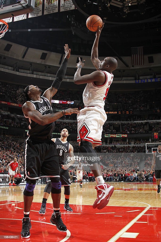 <a gi-track='captionPersonalityLinkClicked' href=/galleries/search?phrase=Luol+Deng&family=editorial&specificpeople=202830 ng-click='$event.stopPropagation()'>Luol Deng</a> #9 of the Chicago Bulls shoots against <a gi-track='captionPersonalityLinkClicked' href=/galleries/search?phrase=Gerald+Wallace&family=editorial&specificpeople=202117 ng-click='$event.stopPropagation()'>Gerald Wallace</a> #45 of the Brooklyn Nets on December 15, 2012 at the United Center in Chicago, Illinois.