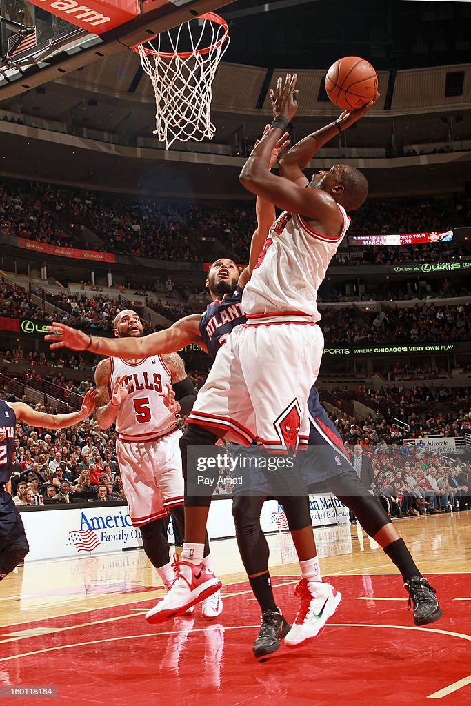 <a gi-track='captionPersonalityLinkClicked' href=/galleries/search?phrase=Luol+Deng&family=editorial&specificpeople=202830 ng-click='$event.stopPropagation()'>Luol Deng</a> #9 of the Chicago Bulls shoots against Mike Scott #32 of the Atlanta Hawks on January 14, 2013 at the United Center in Chicago, Illinois.