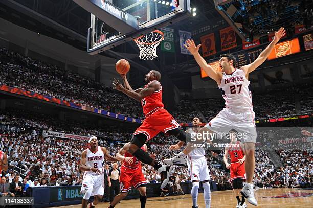 Luol Deng of the Chicago Bulls shoots against Zaza Pachulia of the Atlanta Hawks during Game Six of the Eastern Conference Semifinals in the 2011 NBA...
