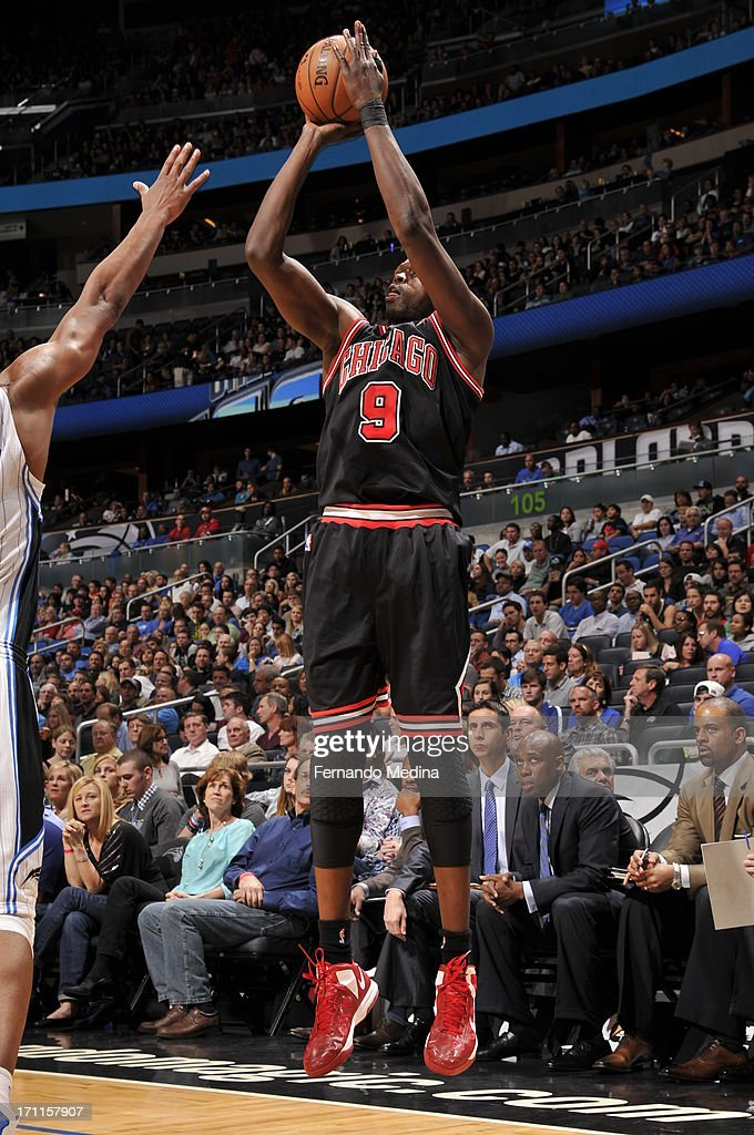 <a gi-track='captionPersonalityLinkClicked' href=/galleries/search?phrase=Luol+Deng&family=editorial&specificpeople=202830 ng-click='$event.stopPropagation()'>Luol Deng</a> #9 of the Chicago Bulls shoots the ball against the Orlando Magic during the game on January 2, 2013 at Amway Center in Orlando, Florida.