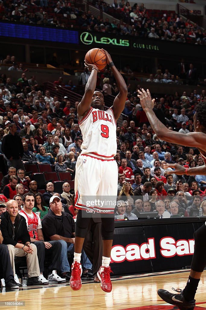 <a gi-track='captionPersonalityLinkClicked' href=/galleries/search?phrase=Luol+Deng&family=editorial&specificpeople=202830 ng-click='$event.stopPropagation()'>Luol Deng</a> #9 of the Chicago Bulls takes a shot against the Milwaukee Bucks on January 9, 2013 at the United Center in Chicago, Illinois.