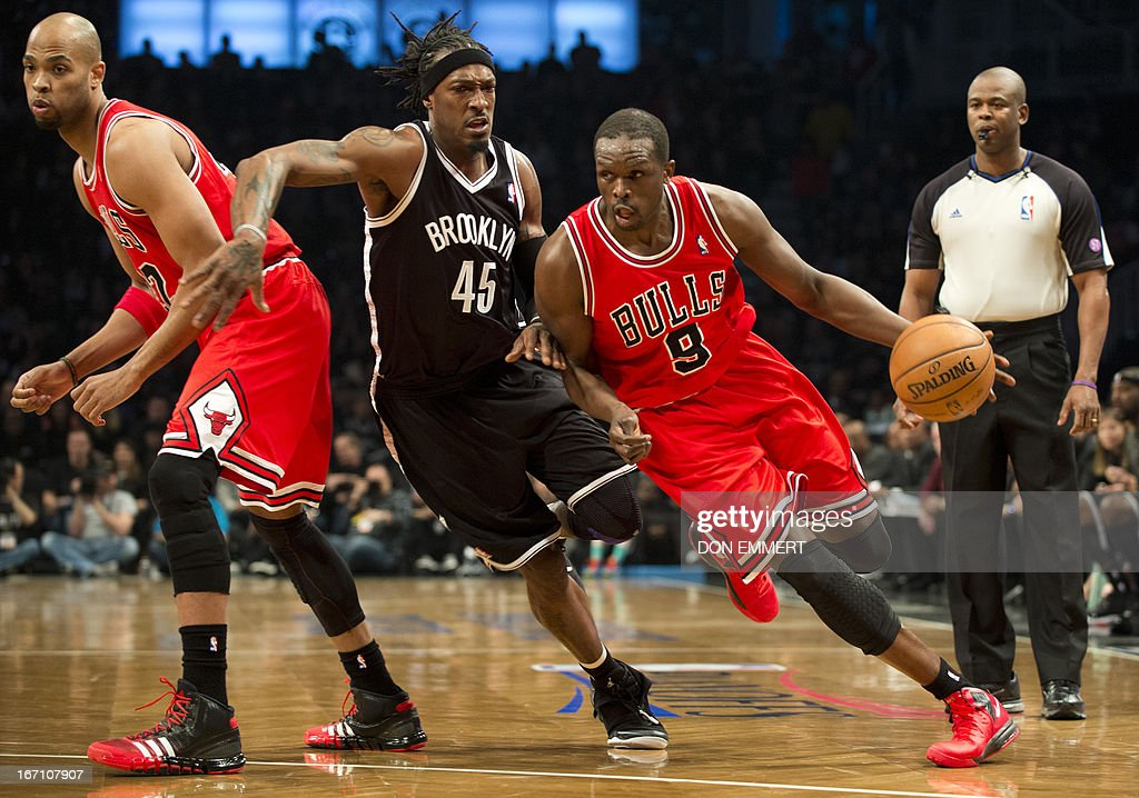 Luol Deng (9) of the Chicago Bulls uses teammate Taj Gibson (22) for a pick as he drives on of the Brooklyn Nets Gerald Wallace (45) during game one of their first round NBA playoff game April 20, 2013 at the Barclay Center in New York. AFP PHOTO/Don Emmert