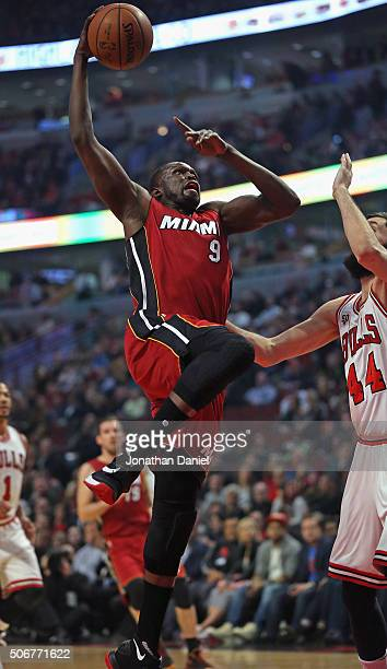 Luol Deng of the Miami Heat goes up for a shot against Nikola Mirotic of the Chicago Bulls at the United Center on January 25 2016 in Chicago...