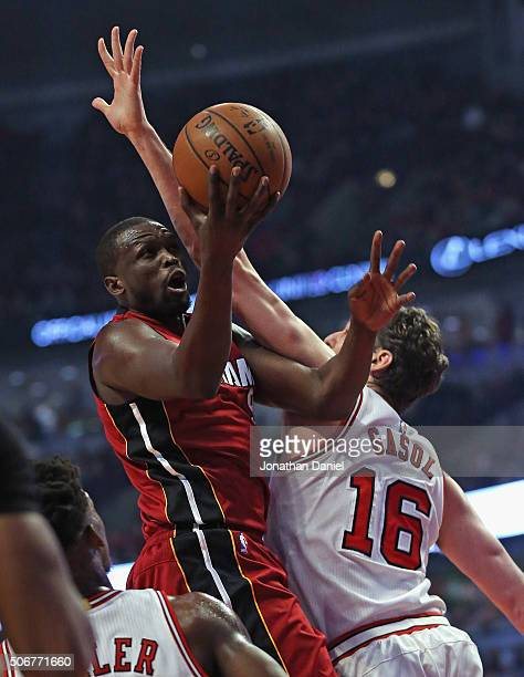 Luol Deng of the Miami Heat goes up for a shot against Pau Gasol of the Chicago Bulls at the United Center on January 25 2016 in Chicago Illinois...
