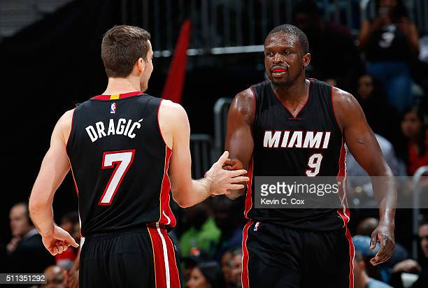 Luol Deng of the Miami Heat reacts after hitting a threepoint basket against the Atlanta Hawks with Goran Dragic at Philips Arena on February 19 2016...