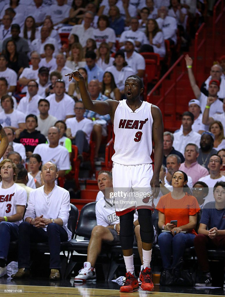 Luol Deng #9 of the Miami Heat reacts to a three pointer during Game Seven of the Eastern Conference Quarterfinals of the 2016 NBA Playoffs against the Charlotte Hornets at American Airlines Arena on May 1, 2016 in Miami, Florida.
