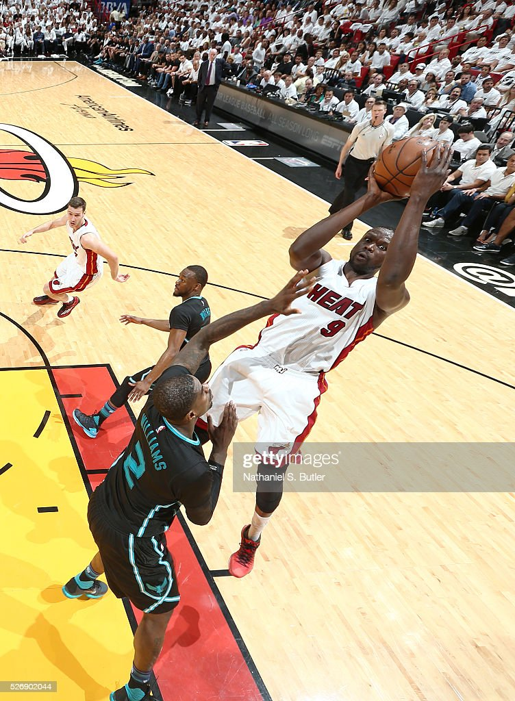 <a gi-track='captionPersonalityLinkClicked' href=/galleries/search?phrase=Luol+Deng&family=editorial&specificpeople=202830 ng-click='$event.stopPropagation()'>Luol Deng</a> #9 of the Miami Heat shoots the ball against the Charlotte Hornets in Game Seven of the Eastern Conference Quarterfinals during the 2016 NBA Playoffs on May 1, 2016 at American Airlines Arena in Miami, Florida.