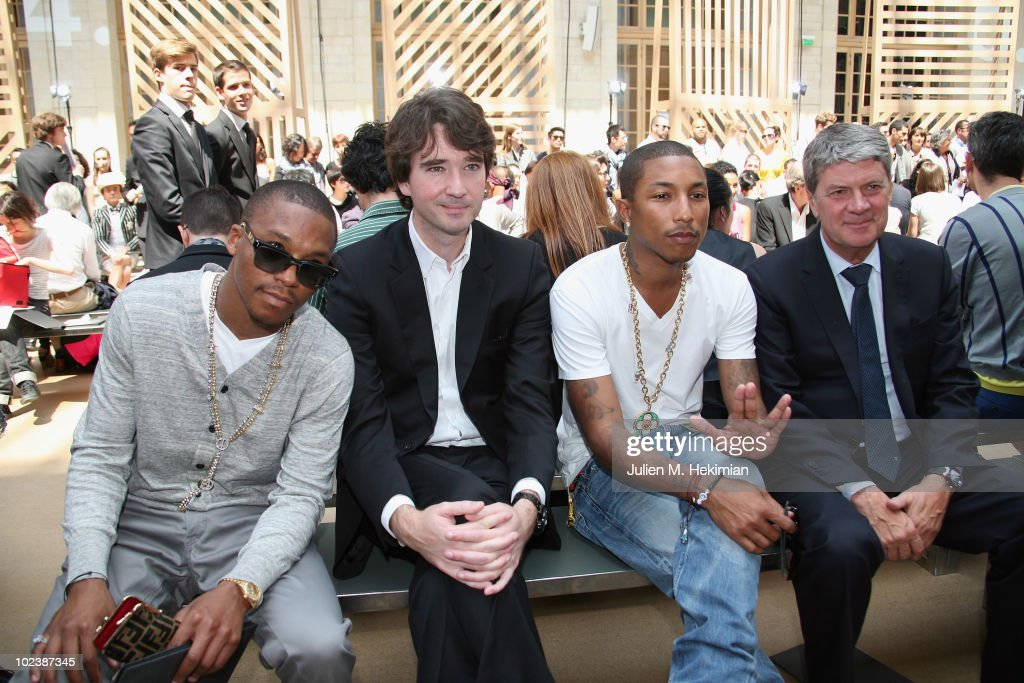 Lupe Fiasco Antoine Arnault Pharrel Williams and Yves Carcelle attend the Louis Vuitton fashion show as part of Paris Menswear Fashion Week...
