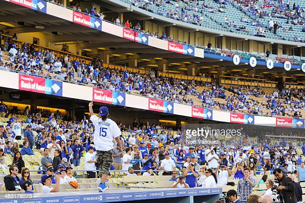 Lupe Fiasco performs during the pre game ceremonies at a baseball game between the San Francisco Giants and the Los Angeles Dodgers at Dodger Stadium...