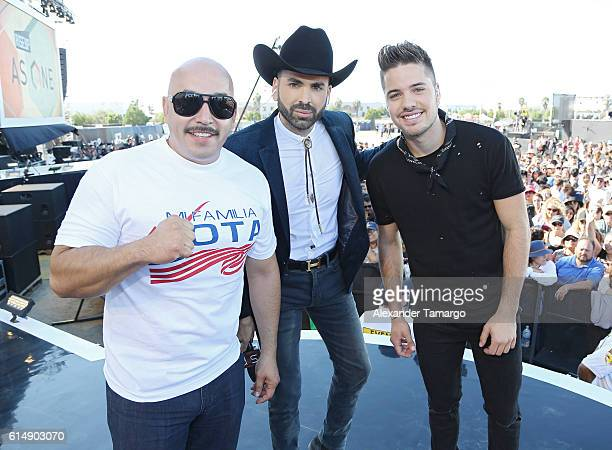 Lupillo Rivera Jomari Goyso and William Valdes are seen on stage during the Univision and Fusion RiseUp As One concert at CBX on October 15 2016 in...